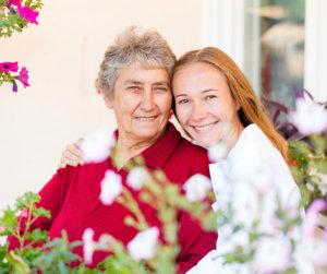 happy grandma besides her caregiver